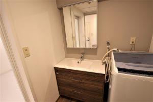 洗面所を拡張して開き戸から引き戸へ!アサヒ衛陶への洗面台交換/京都市北区